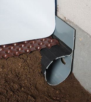 Closeup of a crawl space drainage system installed in Monsey