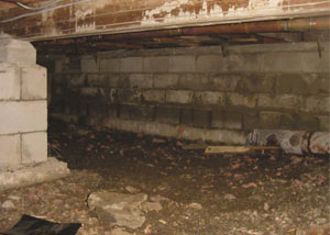Rotting, decaying crawl space wood damaged over time in Kingston