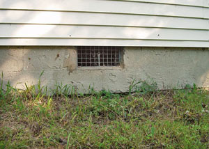 Open crawl space vents that let rodents, termites, and other pests in a home in Wayne